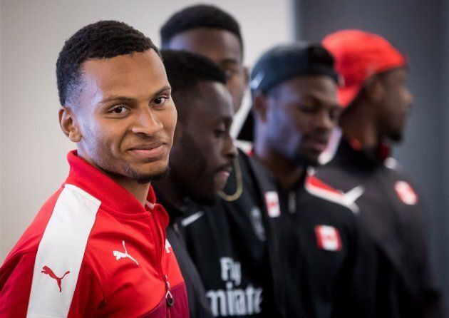 Canadian sprinter Andre De Grasse, front left, of Toronto, stands with the rest of the 4x100-metre relay team during a news conference for the Harry Jerome International Track Classic, in Vancouver, on June 25, 2018.