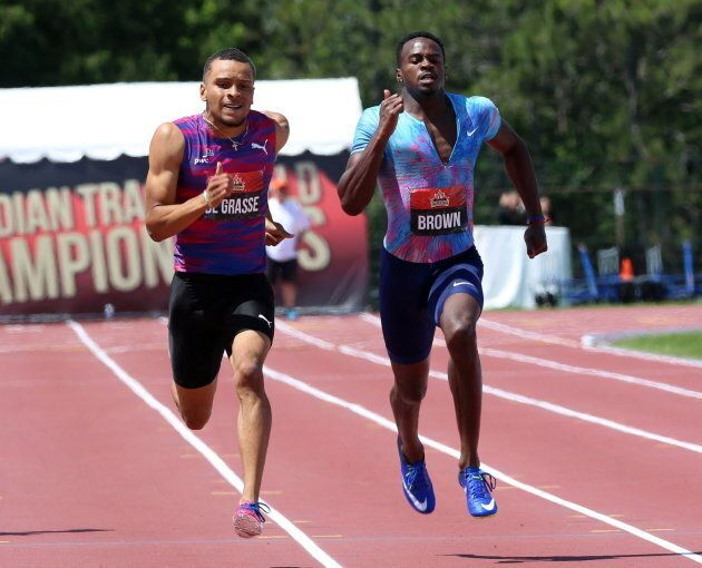 Andre De Grasse, left, takes the lead to the finish line beating Aaron Brown, right, to win gold in men's...