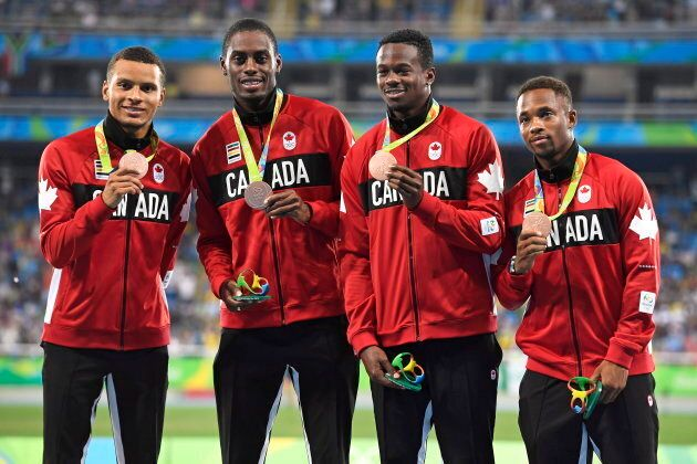 Canada's Andre De Grasse, left to right, Brendon Rodney, Aaron Brown and Akeem Haynes show off their...