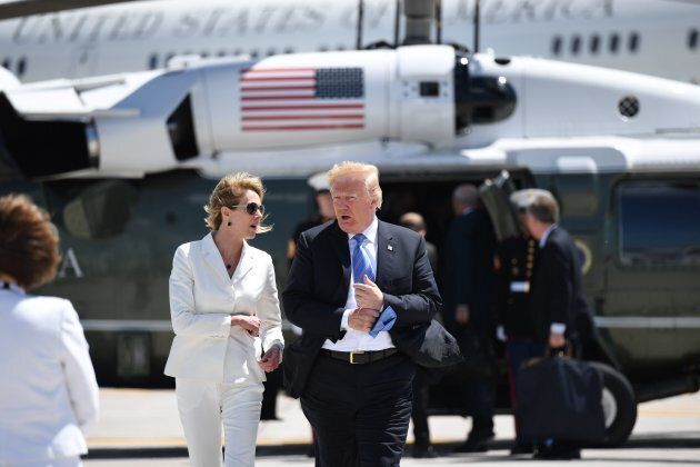 U.S. President Donald Trump with U.S. Ambassador to Canada Kelly Knight Craft walks to Air Force One...