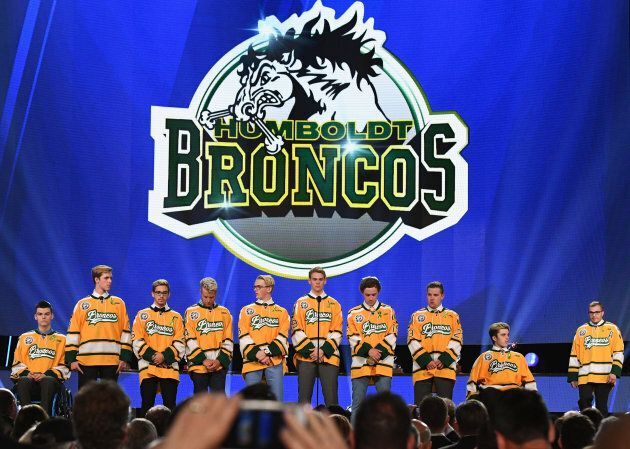 Members of the Humboldt Broncos junior hockey league team stand onstage during the 2018 NHL Awards presented...