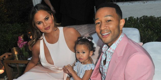 Chrissy Teigen, Luna Simone Stephens and John Legend attend John Legend's launch of his new rose wine brand, LVE, during an intimate Airbnb Concert on June 21, 2018 in Beverly Hills, California.