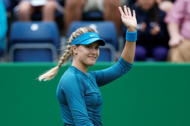 Eugenie Bouchard waves to the crowd after winning her qualifying round match against Australia's Priscilla Hon on June 17, 2018.