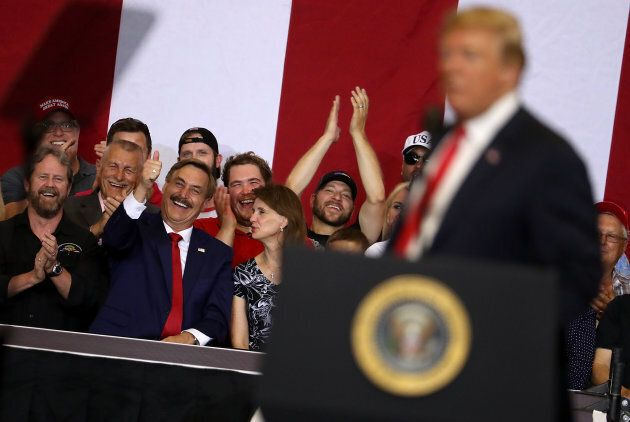Suppoters cheer as U.S. president Donald Trump speaks during a campaign rally at Scheels Arena on June...