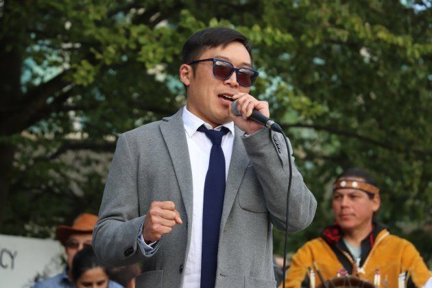 Eugene Kung speaks at the 'No Buyout, No Kinder Morgan' rally on May 29,