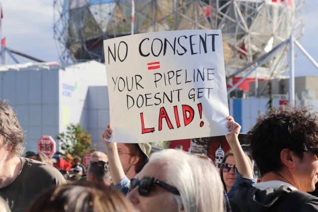 Protestors gather at the 'No Buyout, No Kinder Morgan' rally in downtown Vancouver on May 29, 2018.