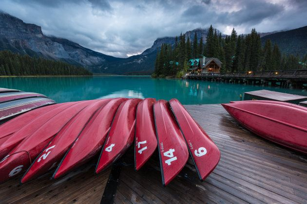 Red canoes on the dock of Emerald Lake in Yoho National Park,