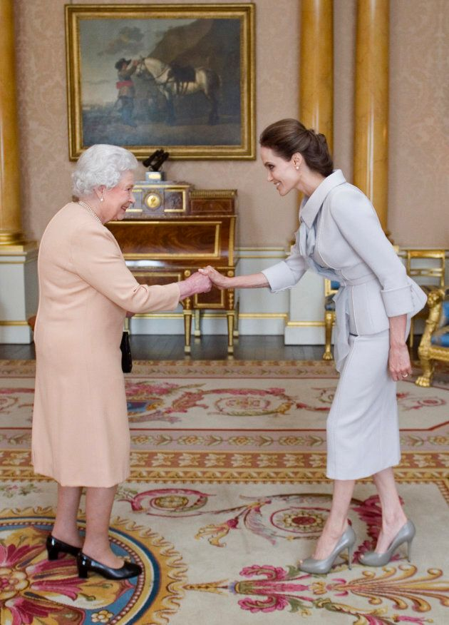 Angelina Jolie is made an honourary dame by Queen Elizabeth II at Buckingham Palace on October 10, 2014.