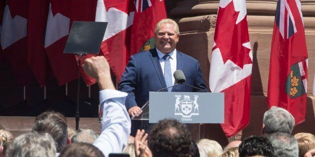 Doug Ford addresses guests and supporters outside the Ontario Legislature in Toronto after being sworn...