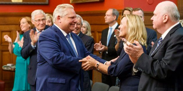 Doug Ford greets new Health Minister Christine Elliott before he is sworn in as premier of Ontario during...