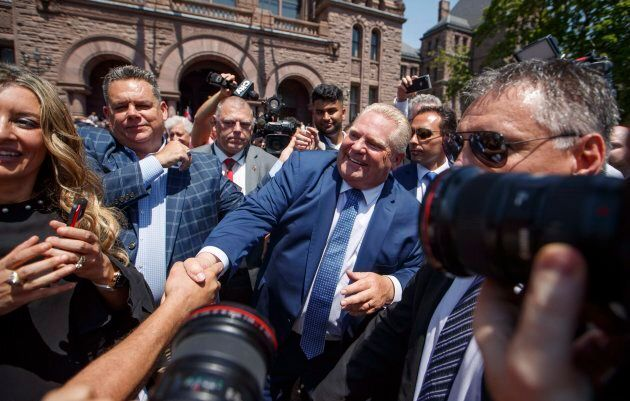 Doug Ford greets people after being sworn in as premier of Ontario during a ceremony at Queen's Park...