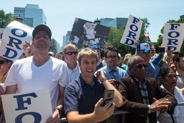 Doug Ford supporters listen to the new Ontario Premier speak outside the Ontario Legislature on June
