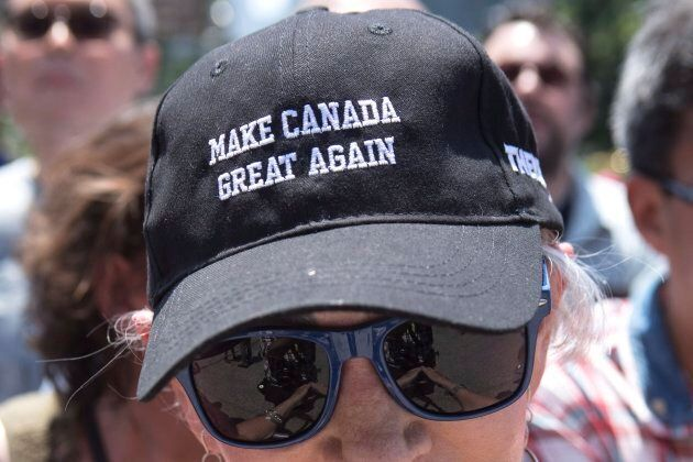 A Doug Ford supporter listens to the new Ontario premier speak outside the Ontario Legislature after...