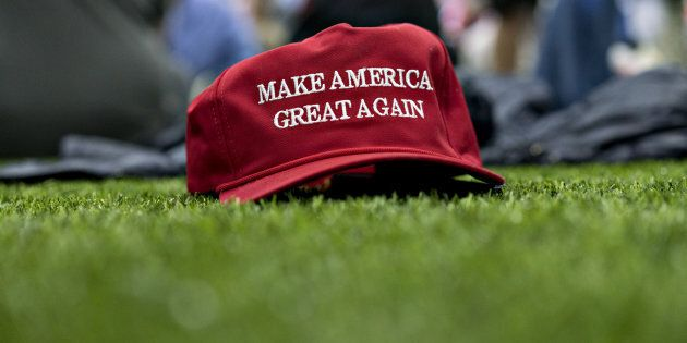 A 'Make America Great Again' hat sits on the ground ahead of a speech by U.S. President Donald Trump...