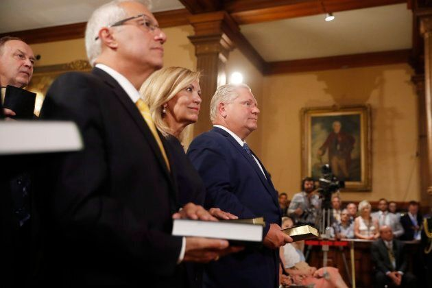 Cabinet ministers Victor Fedeli and Christine Elliott are present at Doug Ford's swearing in ceremony...