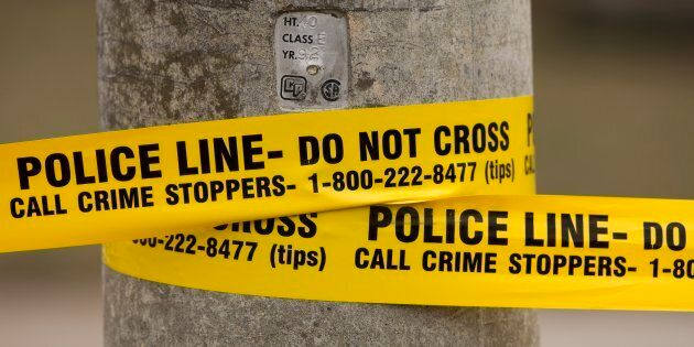Police tape is shown in