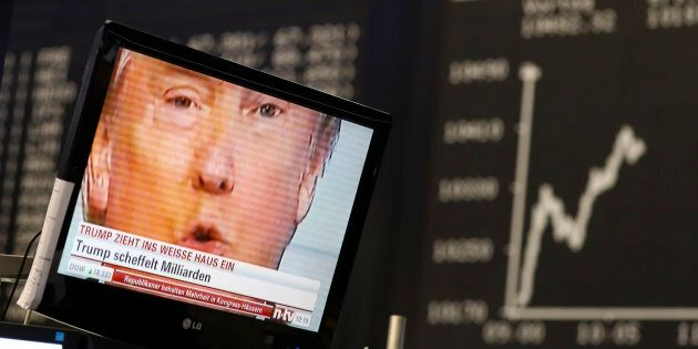 A TV screen showing Donald Trump, then the president-elect, at the stock exchange in Frankfurt, Germany,...