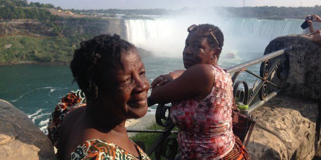 Maizel Hyde-Sinclair, left, and her sister Nellrene Walker, right, at Niagara Falls. While planning to travel back to her native Jamaica for Maizel's funeral, Nellrene and her son Jared discovered WestJet has a