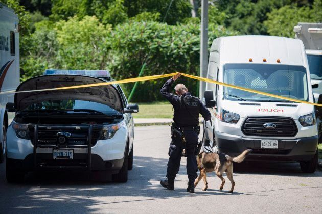 Police investigate the back of a property along Mallory Cres. in Toronto as part of the Bruce McArthur...