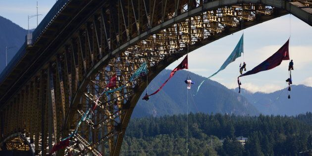 Activists set up to form an aerial bridge blockade in the path of Trans Mountain oil tanker traffic on...