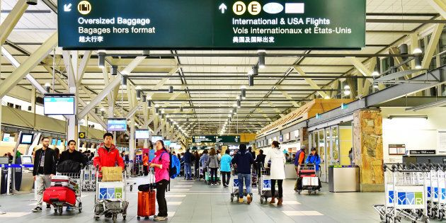 Passengers walking in Vancouver International Airport
