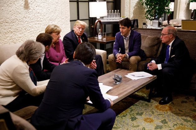 Prime Minister Justin Trudeau and G7 leaders, including U.S. President Donald Trump, pictured to Trudeau's left, hold a meeting with staff on the first day of the G7 meeting in La Malbaie, Que. on June 8, 2018.