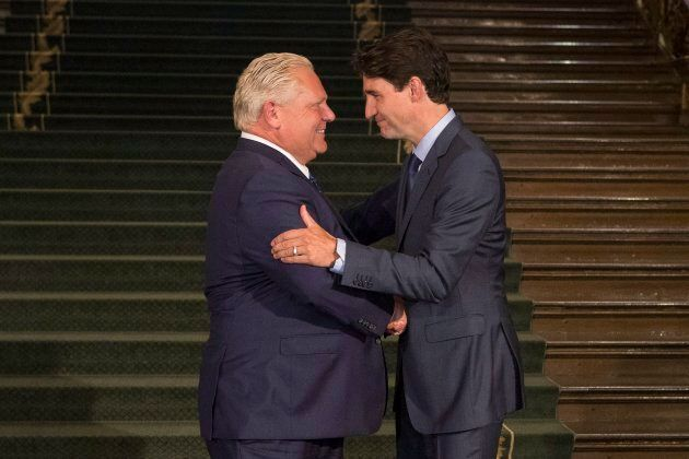 Ontario Premier Doug Ford greets Canadian Prime Minister Justin Trudeau at the Ontario Legislature, in...
