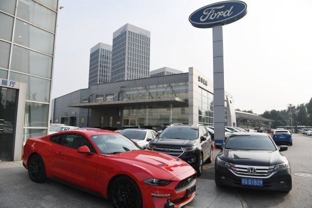 A Ford Mustang is seen at a dealership in Beijing on July 6, 2018. China said it was 'forced to take...