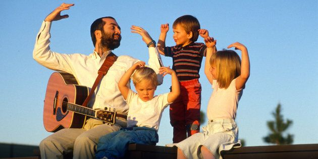 Raffi Cavoukian, better known by Raffi, entertains some children after a concert Sept. 10, 1989 in Los...