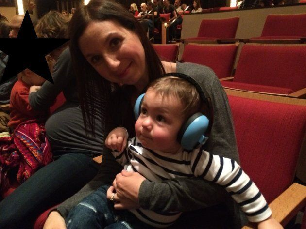 The author and her son, age 1, at a Raffi concert in