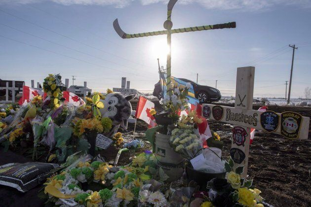 Hockey sticks, messages and other items continue to be added to a memorial at the intersection of a fatal bus crash that killed 16 members of the Humboldt Broncos hockey team last week near Tisdale, Sask. on April 14, 2018.