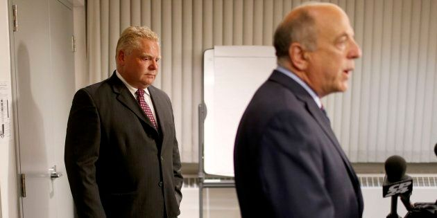 Doug Ford listens to Dr. Rueben Devlin during the press conference about his brother's cancer fight at...