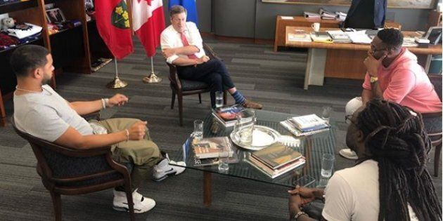 Toronto mayor John Tory met with three prominent members of Toronto's hip-hop community on Friday to...