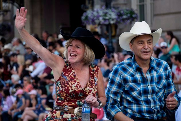 Alberta premier Rachel Notley, left, and finance minister Joe Ceci take part in the Calgary Stampede parade on July 6, 2018.
