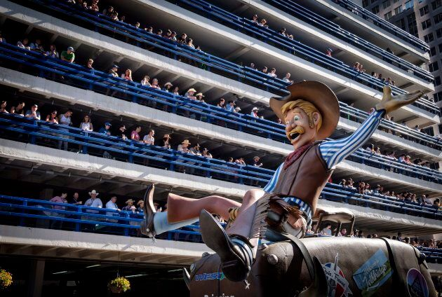 A parade float pass spectators lining a parkade during the Calgary Stampede on July 6, 2018.