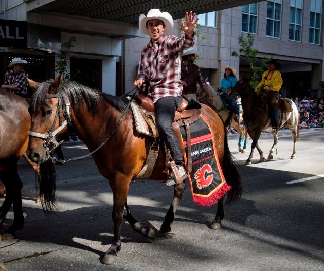 Johnny Gaudreau of the Calgary Flames waves as he rides during the Calgary Stampede parade on July 6, 2018.