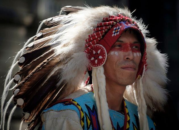A Tsuut'ina band member rides in the Calgary Stampede parade on July 6,