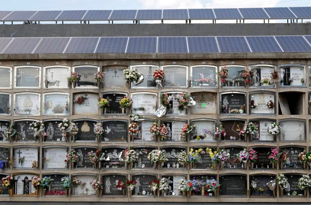 Solar panels fill the roofs of mausoleums in a cemetery in Santa Coloma de Gramanet, near
