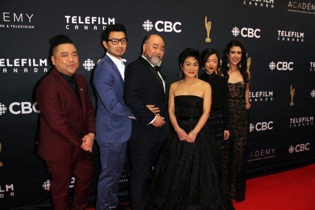 Andrew Phung, left, with Kim's Convenience co-stars Simu Liu, Paul Sun-Hyung Lee, Jean Yoon, Andrea Bang,...