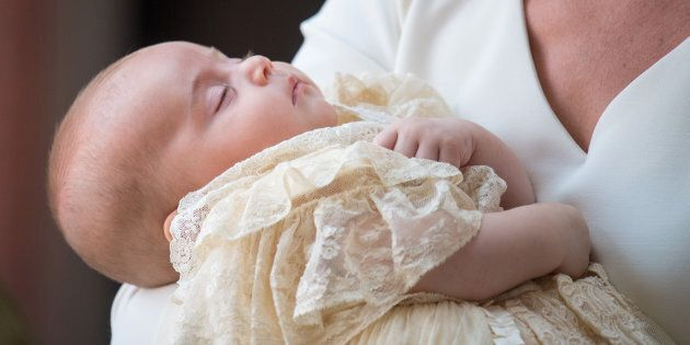 Prince Louis asleep in the Duchess of Cambridge's arms on the day of his christening.