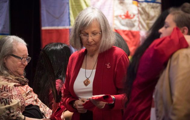 Chief Commissioner Marion Buller presents eagle feathers to a witness following her testimony during the National Inquiry of Missing and Murdered Indigenous Women and Girls in Richmond, B.C. on April, 6, 2018.