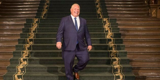Ontario Premier Doug Ford walks down the grand staircase as he waits for Prime Minister Justin Trudeau...