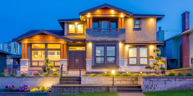 A luxury home is pictured in Vancouver, B.C. The top-tier housing markets in Toronto and Vancouver are headed in opposite directions, with fear driving Vancouver's market lower, Sotheby's says.