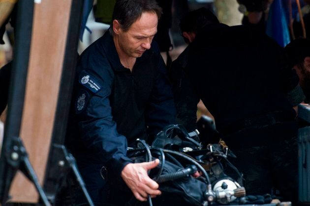 Members of the Australian Federal Police rescue team check their equipment and oxygen tanks during rescue...