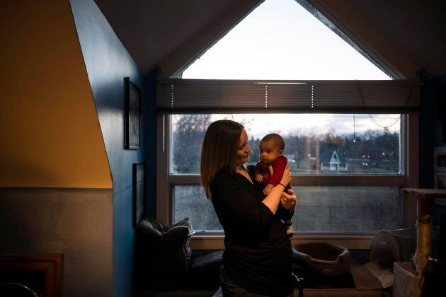 Jessica Wesley holds her two-month-old son Kenneth in her apartment in Toronto on March 3, 2017. A study...