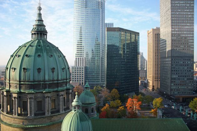 Autumn picture of the dome of the Cathedrale Marie-Reine-du-monde and modern highrise office buildings...