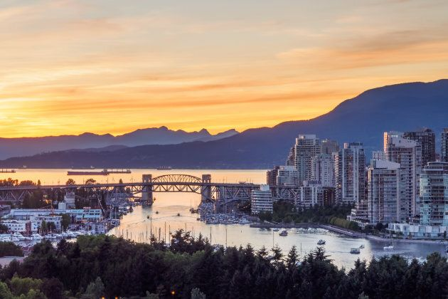 Vancouver skyline with Burrard bridge during sunset.