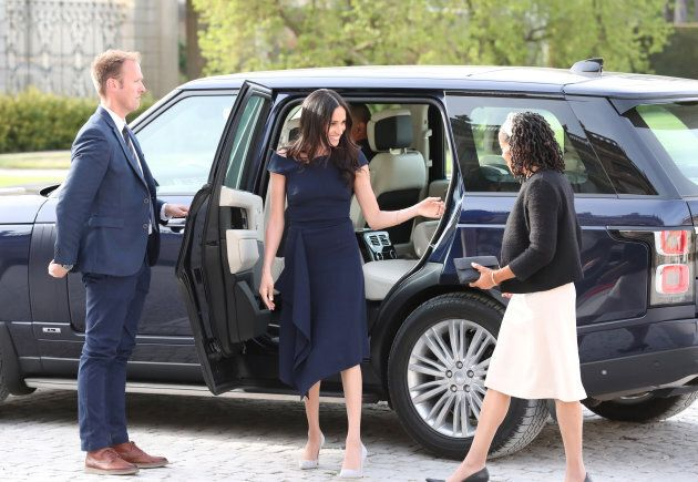 Meghan Markle wearing a Roland Mouret dress a day ahead of her wedding.