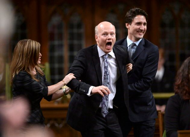 Newly-elected Speaker of the House Geoff Regan jokingly resists as he's escorted to the Speaker's chair...
