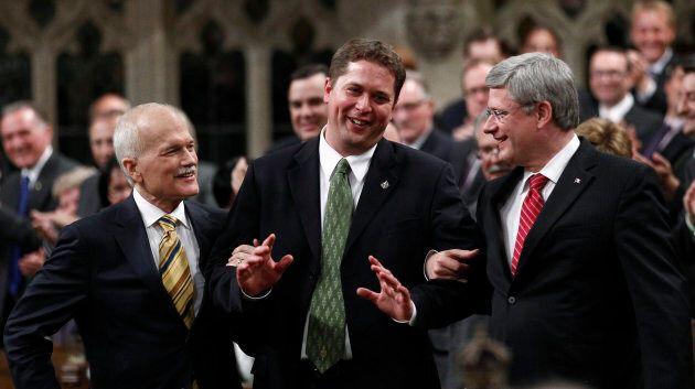 Former prime Minister Stephen Harper and former NDP leader Jack Layton lead Andrew Scheer to the Speaker's...